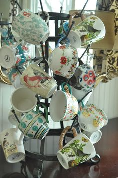 Mismatched mugs on display. Could be a fun display in a kitchen?