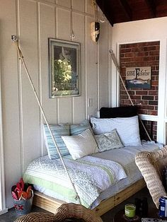 This daybed is so cool. No feet or legs on it... It's 2 x 4's. Think that room has a lovely charm. Looks like a great reading corner... : )