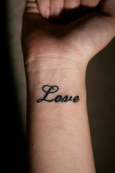 Love wrist tattoo