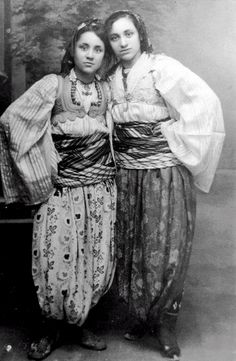 MOTHER TERESA (1910-1997), on the left, as a teen in native Albanian clothing.