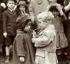 Two kids sharing a soda at the White House Easter Egg Roll. Washington, D.C, 1922.
