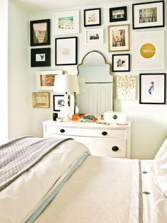 Eclectic #bedroom #gallery wall in front of a white wall and simple #bedding for a focal statement