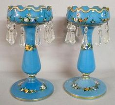 lighting, , A pair of lustres, opaque blue glass with hand enameled flowers and a gilt rim. Faceted teardrop prisms have some ground points. Circa 1850-1950