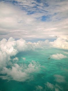 turquoise waters and cloudy blue sky