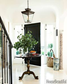 To create a light, airy feel in the entry of his West Hollywood house, visual merchandiser Mark D. Sikes painted the walls New Linen by Kelly-Moore and whitewashed the floors.