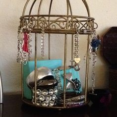 Old bird cage as jewelry holder