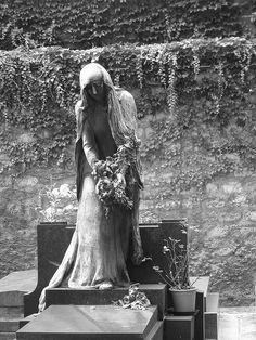 A Paris gravestone by Michael Maniezzo, via Flickr