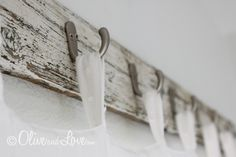 Reclaimed wood with hooks for curtain