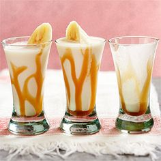 "Banana ""Froster"" Cocktails - medium banana, halved 1 1/2  ounces, (3 tablespoons) creme de banana liqueur, 1 1/2  ounces (3 tablespoons) spiced rum,  3   tablespoons whipping cream, 2   tablespoons  caramel ice cream topping, 3/4  cup ice cubes,   Freshly grated nutmeg (optional)"