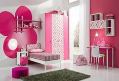 i like the bright pink wall (with white cubbies)