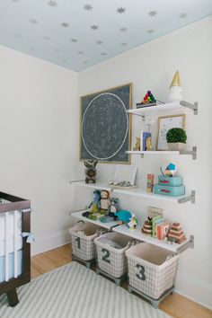 #nursery, #organization, #storage, #shelf, #artwork, #ceiling  Design: Honey  Fitz - honeyandfitz.com/ Photography: Ruth Eileen Photography - rutheileenphotography.com  View entire slideshow: The Ultimate Nursery Round Up on http://www.stylemepretty.com/collection/190/