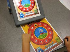 Toddler Jukebox---augmenting apps with simple communication boards