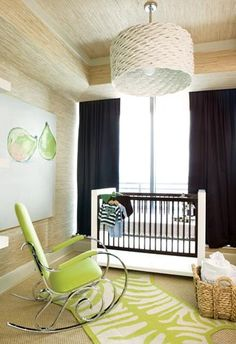 Chic boy's nursery room with large white basketweave pendant, beige grasscloth wallpaper, navy blue drapes, modern crib, lime green modern rocking chair, white & green zebra rug and pear wall art!