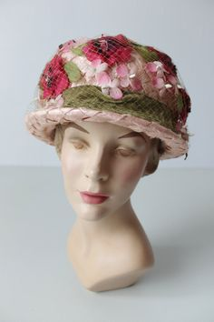 1960's straw cloche with pink flowers and green velvet sash (front view) | Light pink straw hat with a short brim. Light green netting overlay
