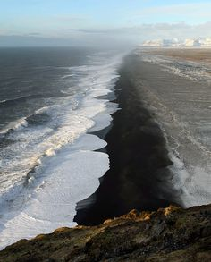 Waves washing onto the black beaches of Iceland