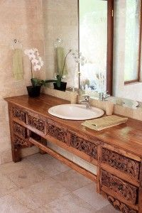 Indonesian bed panel sideboard as sink vanity. Be creative - Indonesian decor works everywhere! Visit gadogado.com to see our collection of Indonesian furniture.