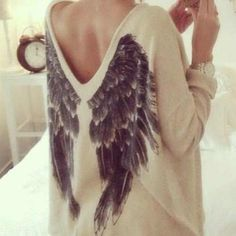 One of my favorites. I adore the simplicity of this loose fitting sweater. Not to mention, the wings are a powerful statement.