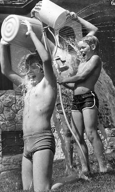 Some things never change — buckets of water and a sprinkler were a good keep-cool tool on a hot summer day in 1980. From left, Corey Harner, Dean Timperley and Jeff Petry have an afternoon of water fun. The boys were 12 years old. THE WORLD-HERALD