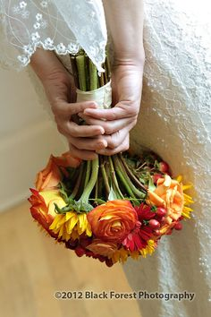 Wedding flower ideas. Colorful fall colored wedding bouquet. Photography by Colorado Springs Wedding photographer: Black Forest Photography http://www.blackforestphoto.com #weddingflowers #weddingbouquet #bride #blackforestphotography #coloradospringsweddingphotography