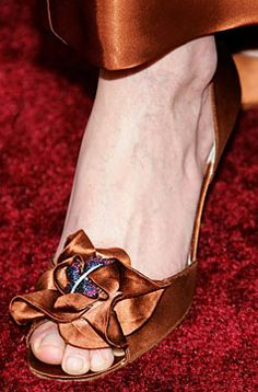 Stuart Weitzman Rita Hayworth Heels. Adorned with rubies, sapphires and diamonds nested in a satin ruffle at the toe. These beauties are worth a staggering $3,000,000.00 owned by Princess Yasmin Aga Khan