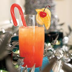 Jingle Juice - vodka and orange liqueur mixed with orange, lemon and maraschino cherry juices, garnished with fruit flavored candy canes