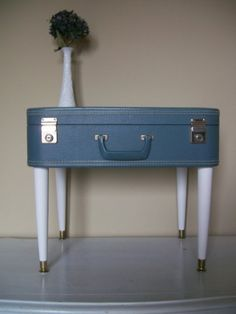 Say hi to vintage suitcase table.