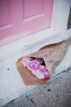 peonies and a pink door