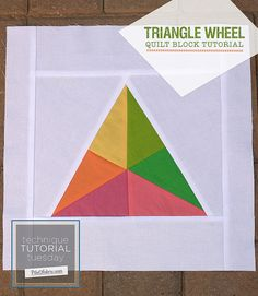 Triangle Wheel Block Tutorial by PileOFabric, via Flickr