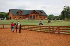 Believe it or not but this is not a log home.  It's a log horse barn! In A Golden Eagle Log Home