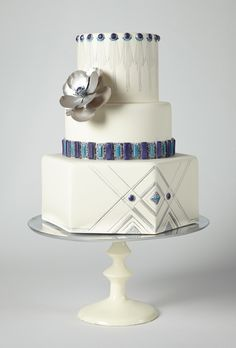 Blue and White Wedding Ideas - Brides.com: . An Art Deco-Inspired Cake with Silver and Blue Accents. Go glam with chic deco design and jewel-toned accents.   Cake by Intricate Icings Cake Design, Erie, CO  Find a wedding cake vendor in Colorado. art deco wedding, cake wedding, art decoinspir, white weddings, themed weddings, cake designs, cake art, white wedding cakes, art cakes