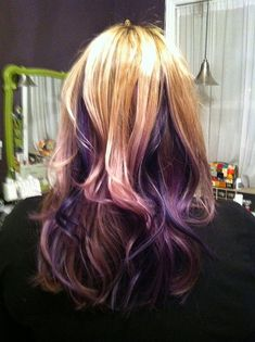 'Hidden' purple streaks with a little bit of blue in my blonde hair. That's right, that was my head the day after I had it done :] I still love it a month later!