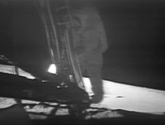 """Neil Armstrong (1930-2012). The first human being ever to step on another world. In this picture he's just about to take that step. ©Mona Evans, """"In the Shadow of the Moon - film review"""" http://www.bellaonline.com/articles/art9746.asp"""