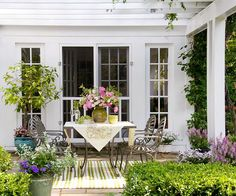 Cozy Corner - Create a cozy corner protected from breezes for a place to enjoy a morning cup of coffee or afternoon tea. Add shade with a pergola overhead. Choose durable furniture that withstands the elements.