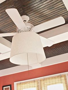 Fan Fabulous  Reinvent the ceiling fan light fixture by spray-painting it white (or any other color in your palette) and replacing the glass globe with a drum-style shade.