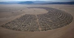 """The Burning Man 2011 """"Rites of Passage"""" arts and music festival is seen in this aerial view taken in the Black Rock desert. (Jim Urquhart/Reuters)"""