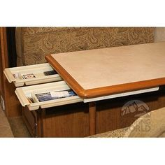 Under table storage drawers in camper - Could be applied to any freestanding table in a Tiny House...  -  To connect with us, and our community of people from Australia and around the world, learning how to live large in small places, visit us at www.Facebook.com/TinyHousesAustralia