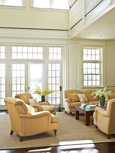 French doors open up this spacious living room to the back porch - Traditional Home® / Photo: Tria Giovan / Design: Ken Gemes