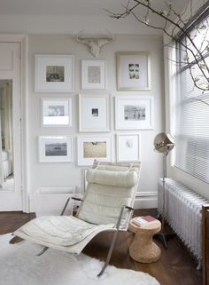 display of white frames on a white wall  {walls of white}