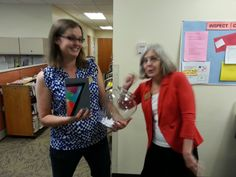 Teen intern Abby and Library Director Maggie drawing the winners for the Teen's Summer Reading Game grand prizes.