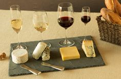 Wine & Cheese Served On A Slate Board.