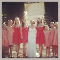 Persimmon bridesmaid dresses with jr bridesmaids in coral. Thank you Pinterest for the cute idea.