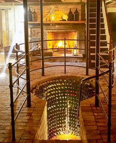 Awesome! This is a fabulous wine cellar, cool floor, and that fire...Wow!