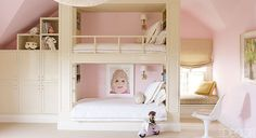 An attic Loft Girls Playroom with fun custom made bunk beds and a window seat from Elle Decor