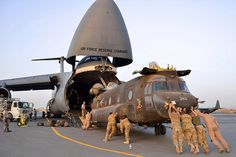 New York Army National Guard load helicopters onto a plane