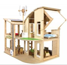 Green Dollhouse by Plan Toys features a wind turbine, a solar panel, a rain barrel and recycle bins. On sale $154.99