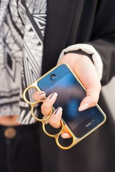 This reminds me of the stylish Alexander McQueen knuckle clutch bags only it is a stylish phone :)   #PurelyInspiration