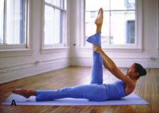 The dancer's curl works your legs and abs. Click for the full Dancer's Body Workout!