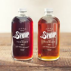 Pure Maple Syrup -- white script on a bottle filled with dark syrup, contrasting whimsical & straight text