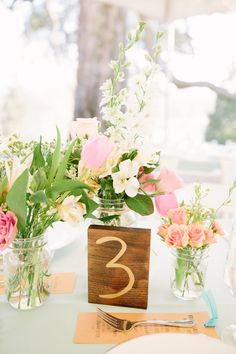 wooden table numbers, photo by Emily March Photography http://ruffledblog.com/tuckahoe-plantation-wedding #tablenumbers #centerpieces #weddingreception