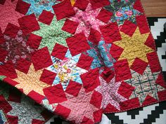 Red, Red Stars quilt - Stitched in Color kona rich red and anna maria horner fabrics with a sawtooth star pattern quilt. i love this so much.